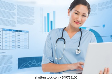Smiling female surgeon using a laptop against blue data