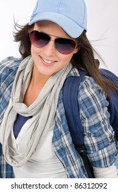 Smiling female teenager girl wear cool outfit and sunglasses