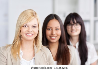 smiling female trainees standing in the office