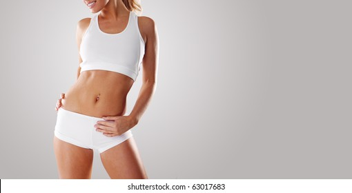 Smiling fitness beauty sexy woman exercising