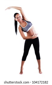 Smiling fitness woman making stretching exercises isolated on white