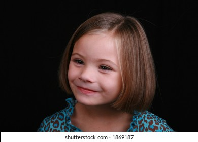 smiling five year old survivor of fetal alcohol syndrome