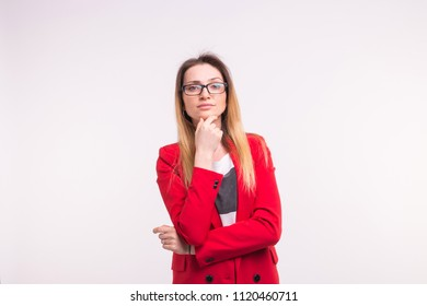 Smiling freckled beautiful woman with hand on her chin on white background with copy space