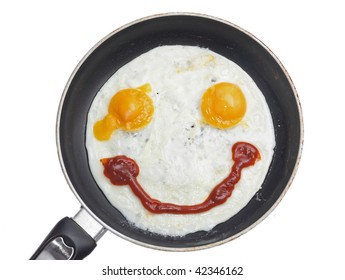smiling fried eggs on the frying pan