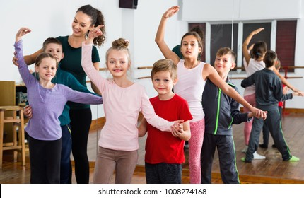 Smiling  friendly children studying of partner dance  at dance school