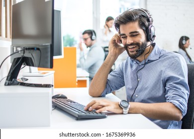 Smiling friendly helpline technical support operator in call centre