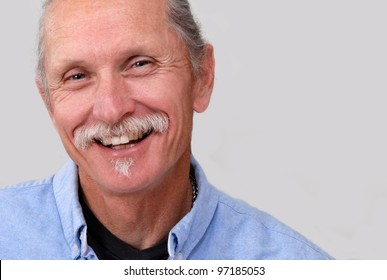 Smiling, friendly, relaxed middle aged man on white background.