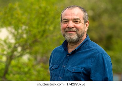 Smiling friendly unshaven adult man outdoors portrait