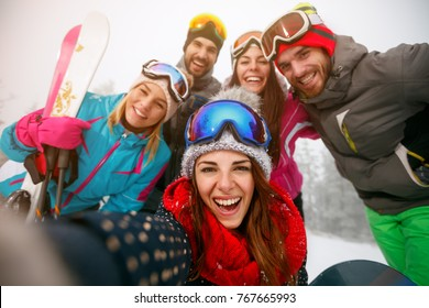 smiling friends making selfie and having fun on winter hodays