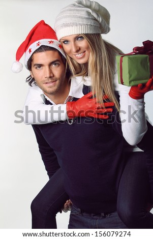 Smiling And Funny Christmas Couple White Backdrop