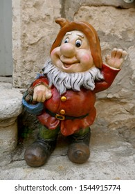 Smiling garden gnome with red jacket. (not protected by copyright)