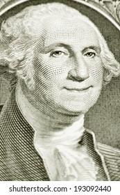 A smiling George Washington on a one dollar bill, close-up