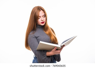 Smiling ginger woman in shirt holding and reading book