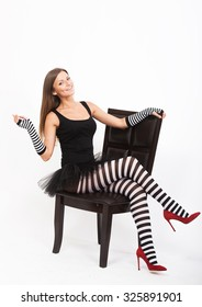 Smiling girl in black and white striped tights