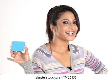 Smiling girl with blue credit card