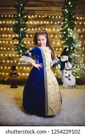 smiling girl in blue princess dress at seesaw