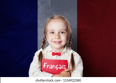Smiling girl with book against French flag banner. Learning french