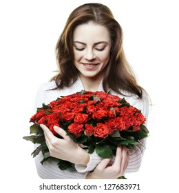 smiling girl with bouquet of red roses isolated on white