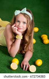 Smiling girl with bright yellow lemons