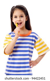 Smiling girl brushing teeth, isolated on white