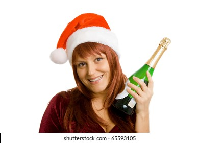 Smiling girl in a Christmas hat with a bottle of champagne in hand. White isolated background