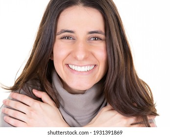 Smiling girl closeup brunette woman in grey sweater posing with crossed arms folded