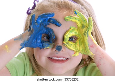 Smiling Girl with coloured hands after painting session
