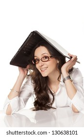 smiling girl covers her head with a laptop on white background
