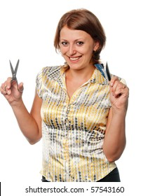 Smiling girl cuts a credit card, refusal of crediting