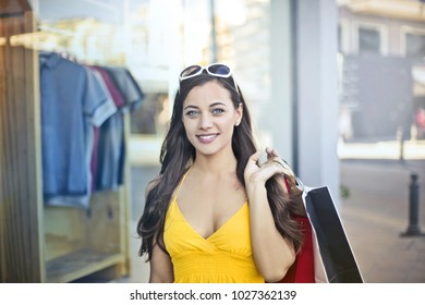 Smiling girl doing shopping