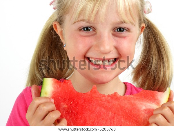A smiling girl eating a water melon