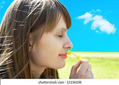 smiling girl enjoying flower