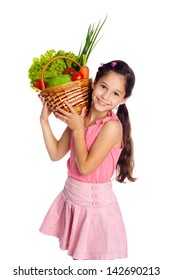 Smiling girl with fresh vegetables in basket, isolated on white