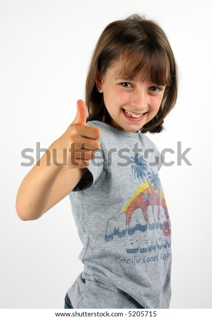 Smiling girl giving thumbs up against white background