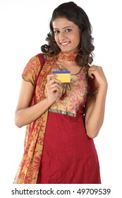 Smiling girl with gold card