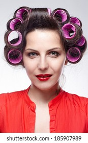 Smiling girl with hair rollers