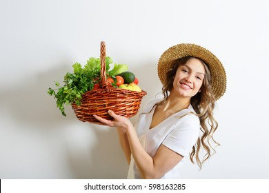 Smiling girl with a healthy food basket