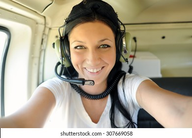 Smiling girl in the helicopter.
