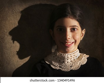 Smiling girl and her werewolf shadow. Halloween picture.