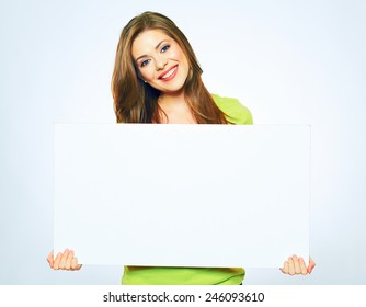smiling girl holding blank sign board. studio portrait of young woman with sign card. isolated.