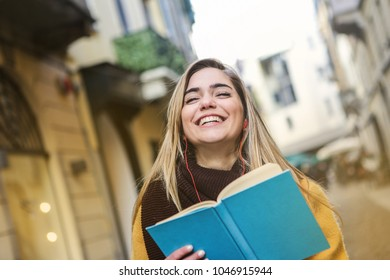 Smiling girl holding a book