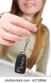 Smiling girl holding car key