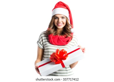 Smiling girl holding gifts gift in santa hat isolated on white background.