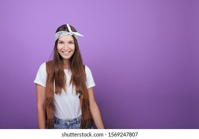 Smiling girl iphoto on a purple background. Young student. Pupil. A generation of millennials. Retro style.