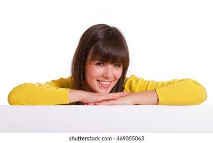 smiling girl leaning over white board
