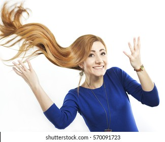 Smiling girl with long flying hair. Portrait of a redheaded girl. Beautiful happy woman