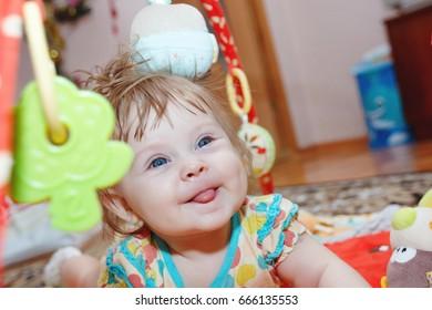 smiling girl lying among the toys