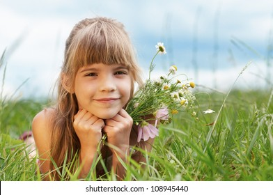 smiling girl lying on grass