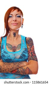 A smiling girl with many tattoos