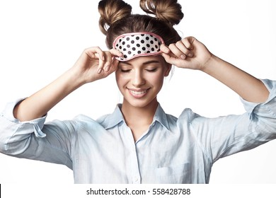 Smiling girl in mask sleeping with eyes closed